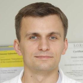 Dr. Simonas Grybauskas DDS, MD, PhD, MOS RCSEd